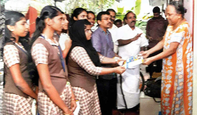 Distributing booklets on diseases to residents