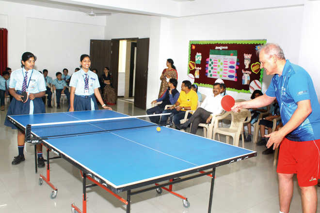 Students Get Table Tennis Lessons From Olympic Coach
