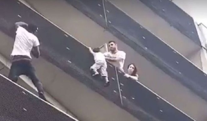 Watch Man Climbs Building To Save Child
