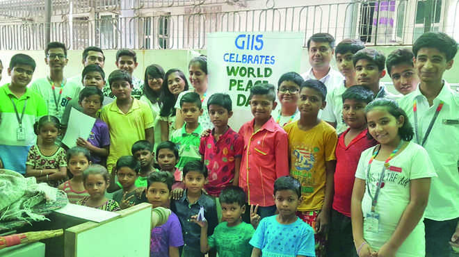 GIIS celebrates Peace Day with slum kids