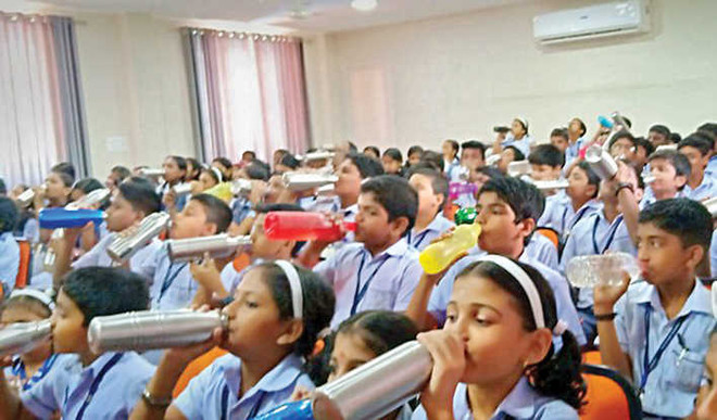 Bell, music to alert children to drink water