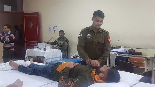 Enthusiastic Volunteers Donate Blood At Camp