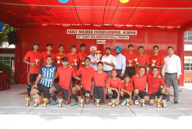 Host School Lifts Football Trophy