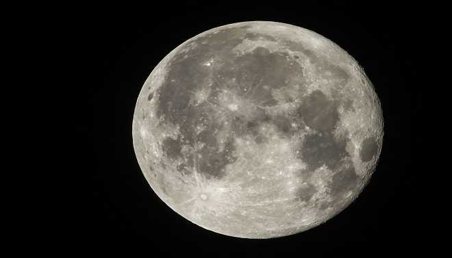 Massive Impact Shaped Moon's Two Faces