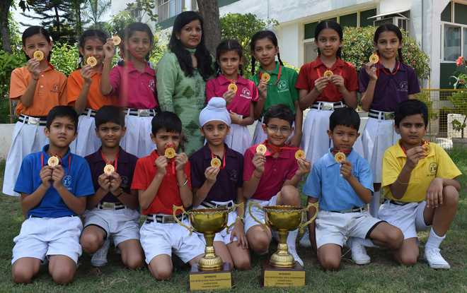 Yogis Of St Xavier's Display Expertise & Lift Champions Trophy