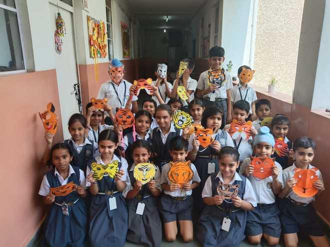 Students Make Creative Tiger Masks During Activity