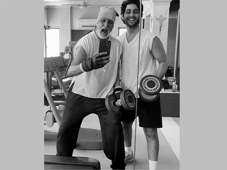 Big B Sweats It Out With Grandson