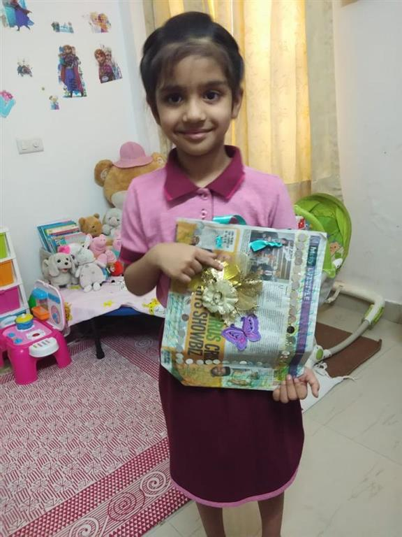 MRIS kids unleash creativity while upcycling paper into gift bags