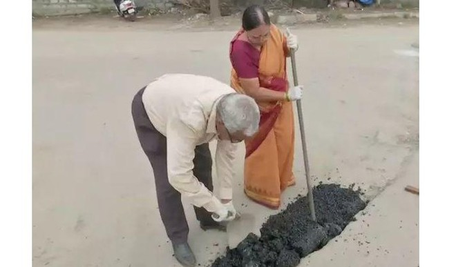 Couple Spends Pension To Fill Potholes